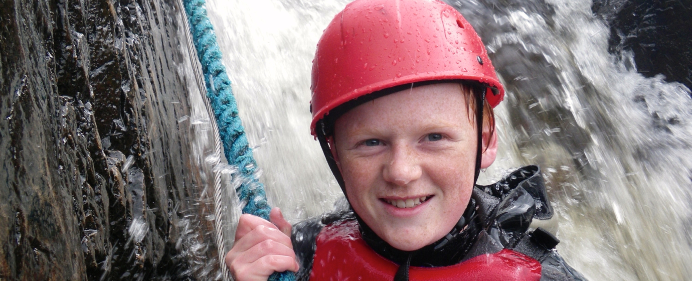 Wee lad on waterfall